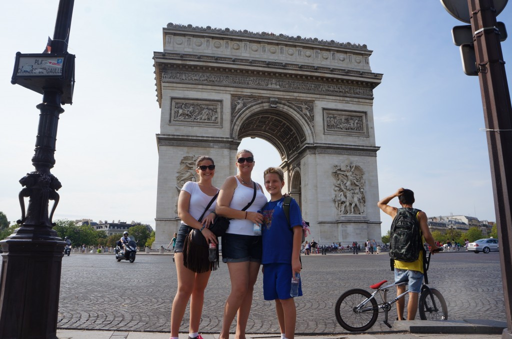 Pedersens outside the Arch de Triumphe in France