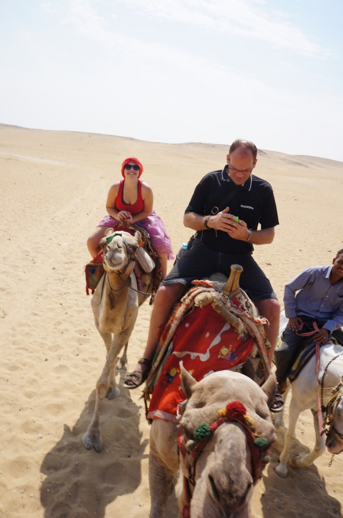 Checking iphone photos in the desert!