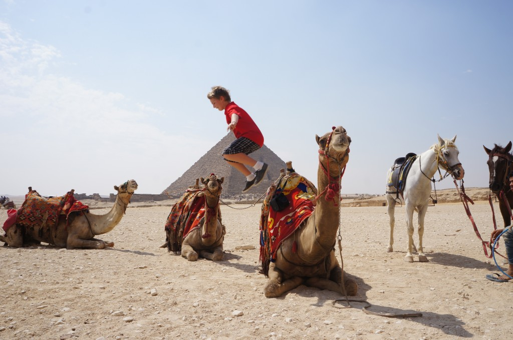 Jono jumping off a camel in Egypt - Life changing year