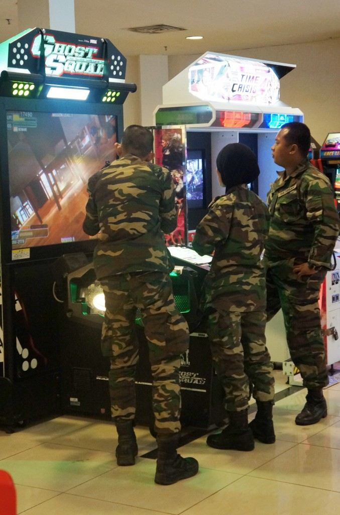 Army men playing army computer games in Malacca!