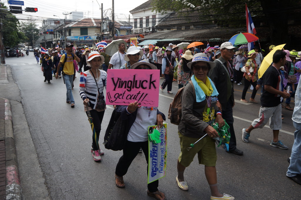 Yingluck get out says a shutdown bangkok protest sign