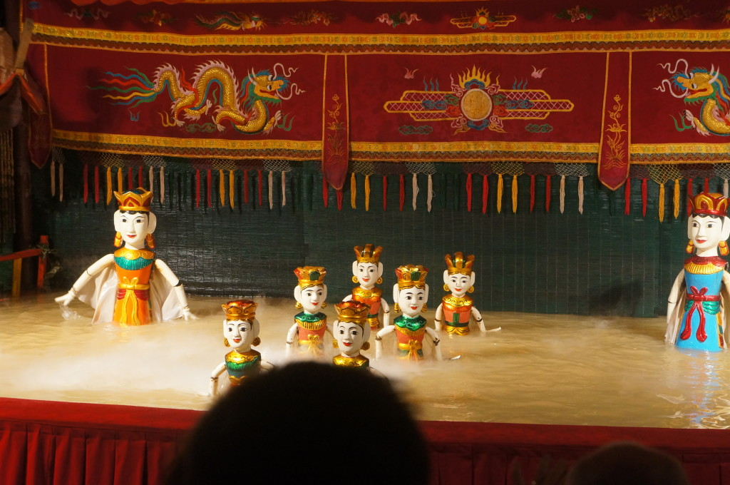 Vietnamese water puppets complete with heads in the way!